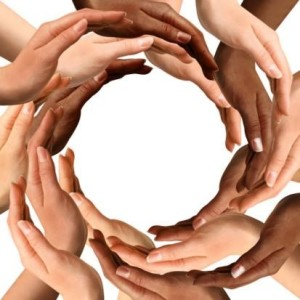 multi ethnic hands in circle